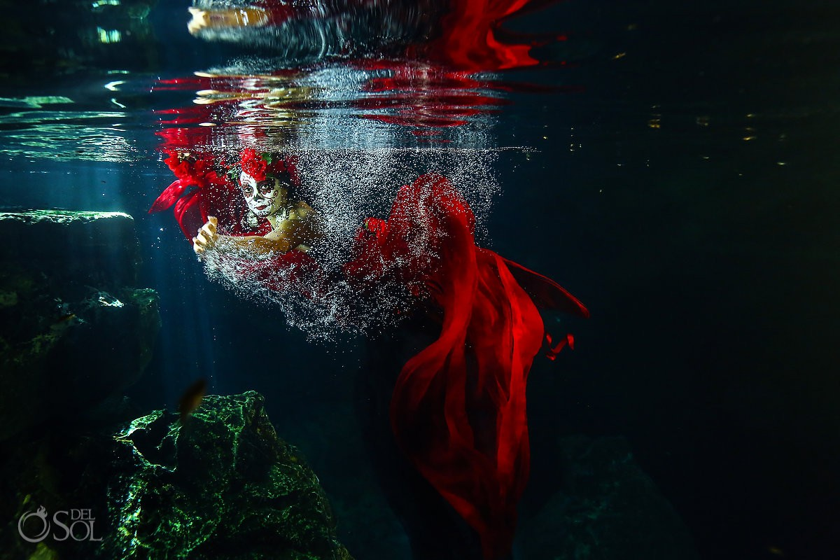 Underwater photography model in red dress clear water cenote Riviera Maya