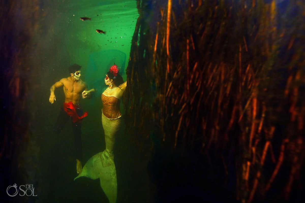 Underwater photography couple at green water cenote Riviera Maya