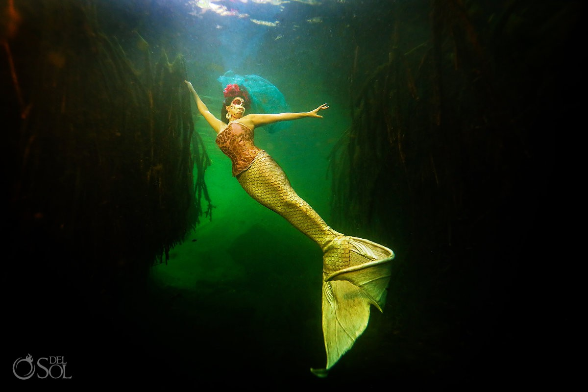 Underwater photography at cenote Riviera Maya mermaid tail by Sirenis