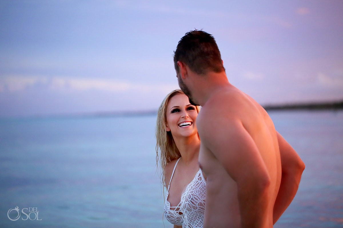 romantic sexy beach boudoir bride smiling at Sunset Dreams Tulum Mexico