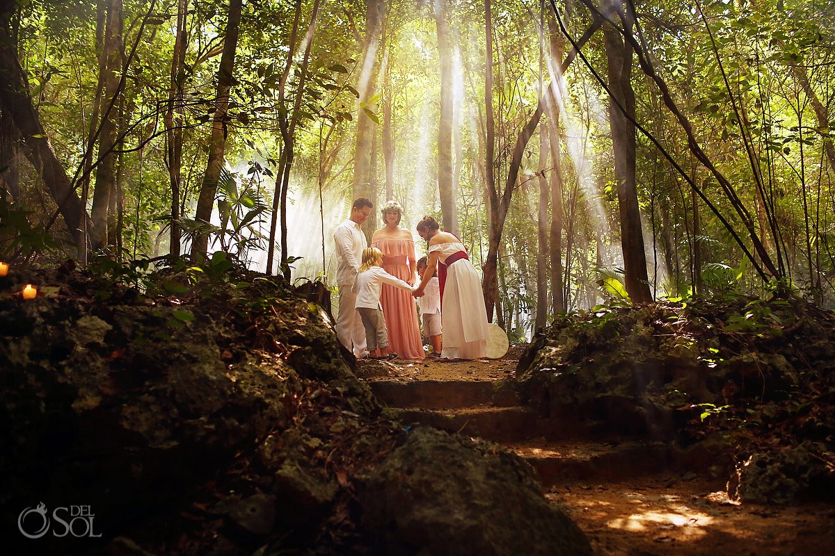 Family vow renewal spiritual ceremony middle jungle Cenote Riviera Maya Mexico