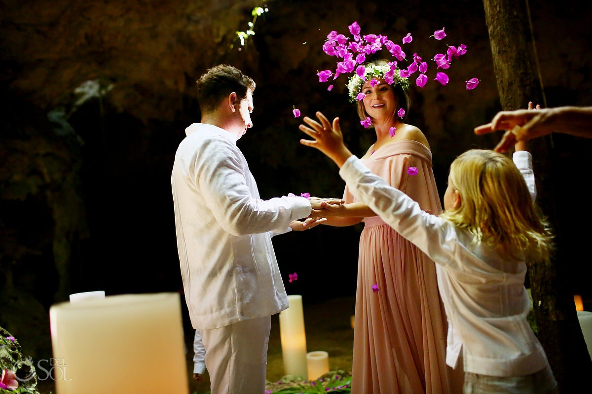 Son throwing flowers symbolic vow renewal ceremony Tulum Riviera Maya Mexico