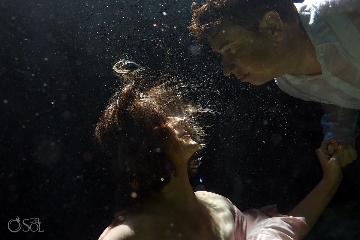 underwater love bride and groom almost kiss Cenote Riviera Maya Mexico
