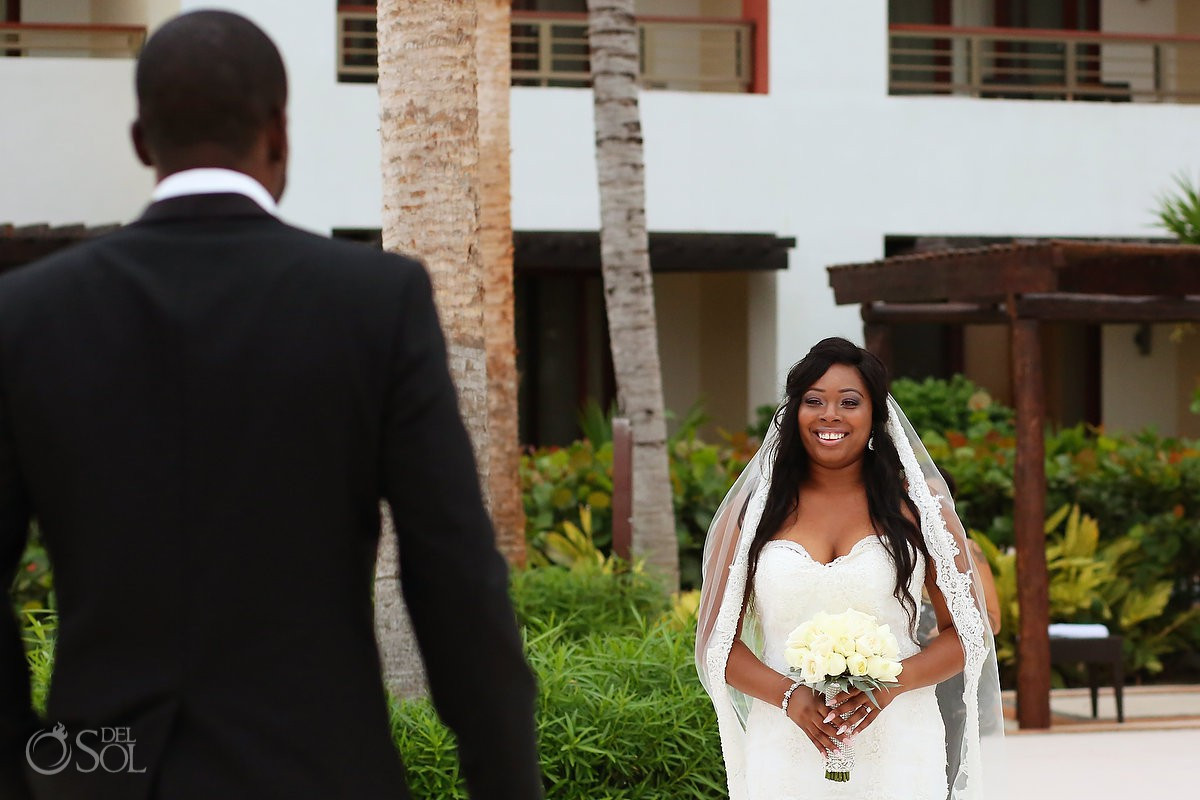 Destination wedding ceremony first look bride and groom Secrets Playa Mujeres Golf & Spa Resort Cancun Mexico
