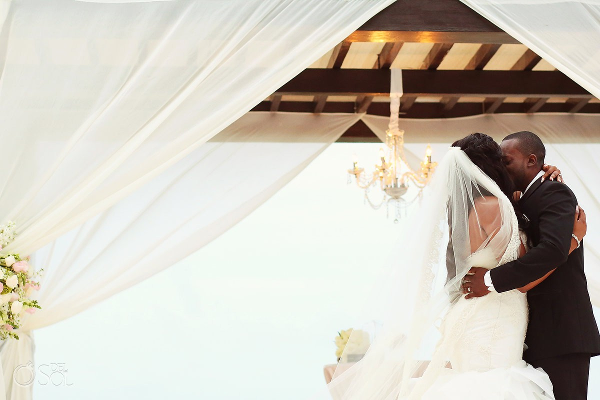 Bride and groom first kiss Secrets Playa Mujeres Golf & Spa Resort Cancun Mexico