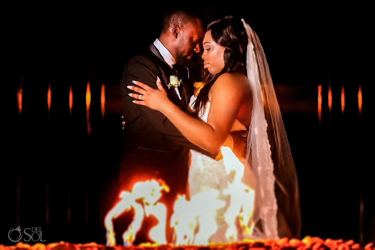 Bride and groom fire love just married Secrets Playa Mujeres Golf & Spa Resort Cancun Mexico