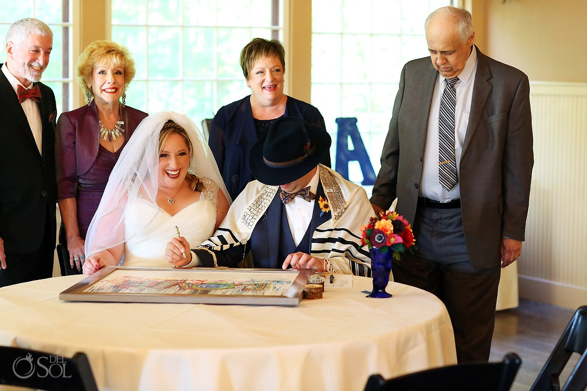 Jewish wedding ceremony Rabbi signing the ketubah Bolton Valley Resort Vermont United States
