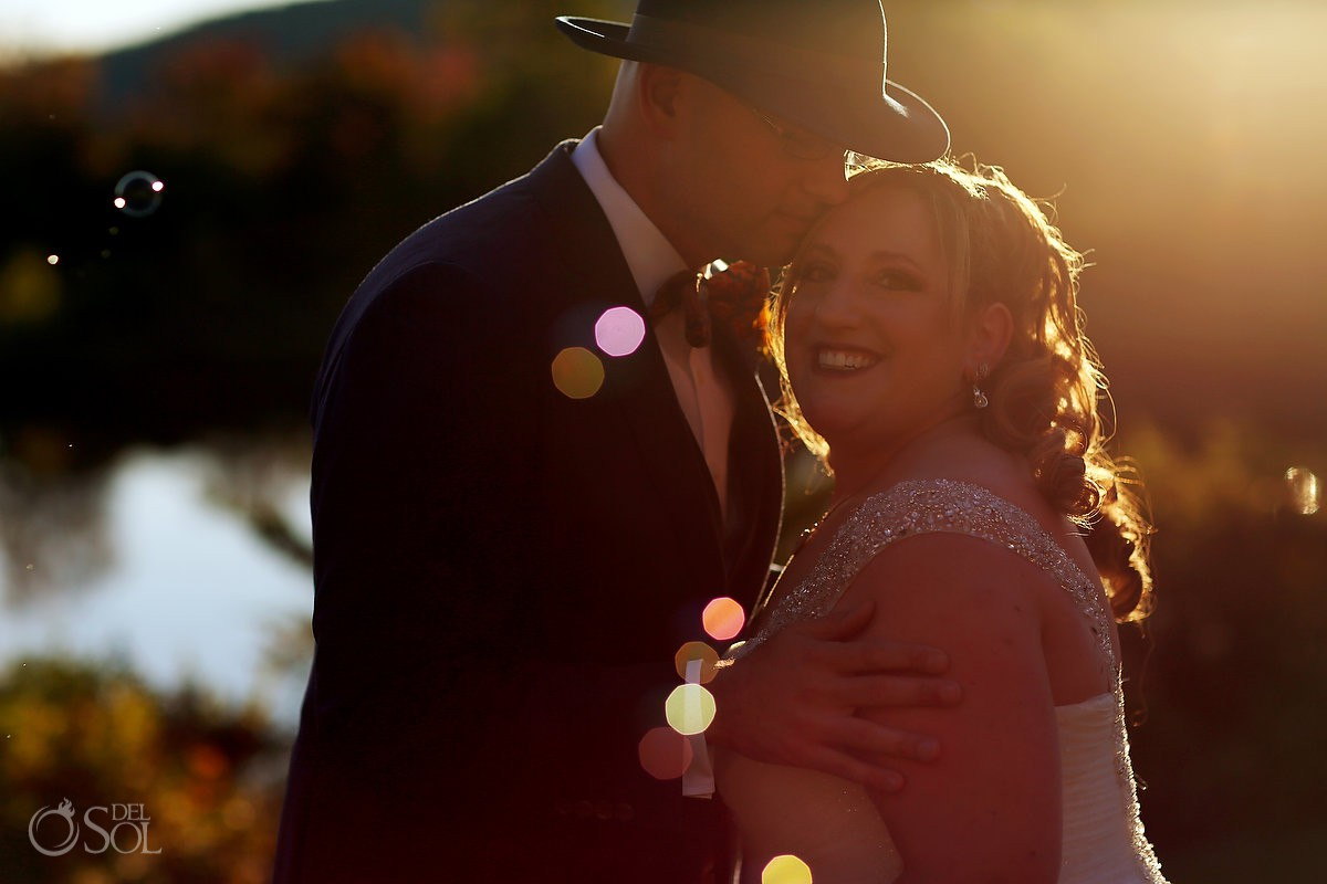 Bride and groom sunset light romantic portraits Bolton Valley Resort Vermont United States