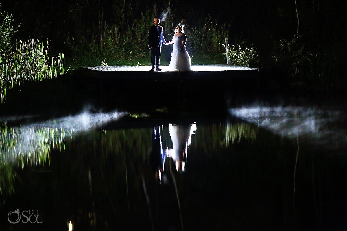 Bride and groom with cold breath at The Ponds at Bolton Valley Vermont