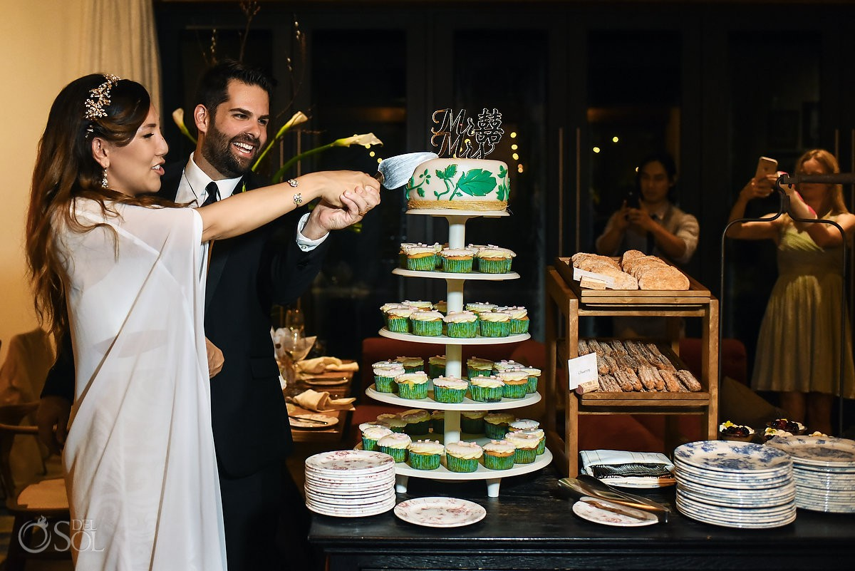 Cake cutting time casa amate Hyatt Andaz Mayakoba wedding Playa del Carmen Mexico.