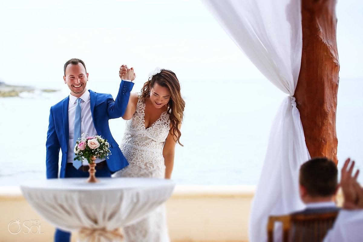 Bride and groom celebrating just married Dreams Puerto Aventuras Riviera Maya Mexico