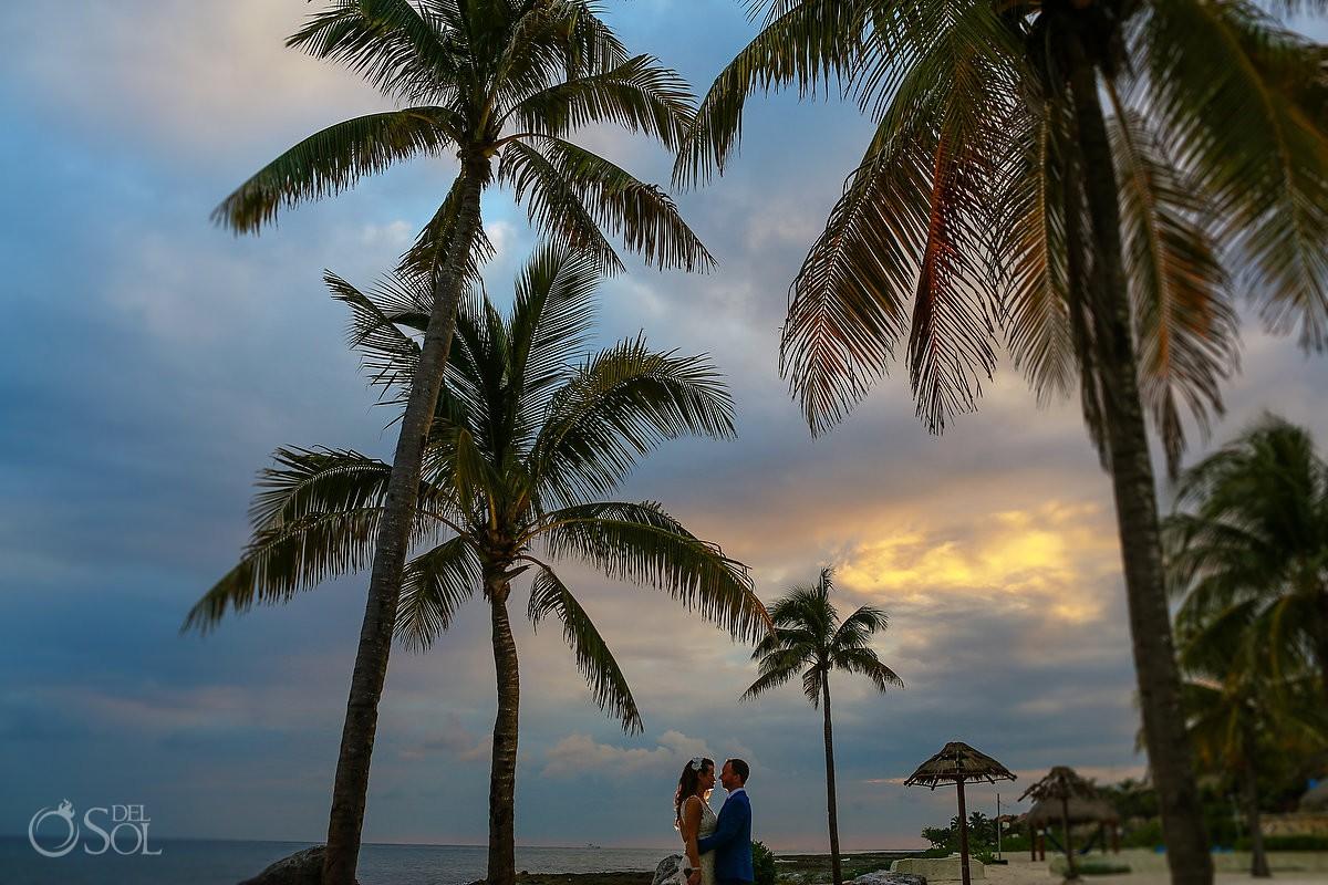 bride and groom palm trees silhouette Dreams Puerto Aventuras Riviera Maya Mexico