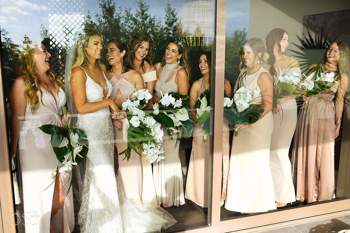 bride and bridesmaids reflection portrait getting ready moments before ceremony Nizuc Resort Cancun Mexico
