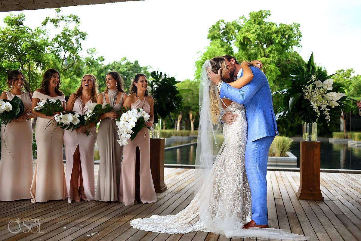 Bride and groom first kiss destination wedding Nizuc Resort Cancun Mexico