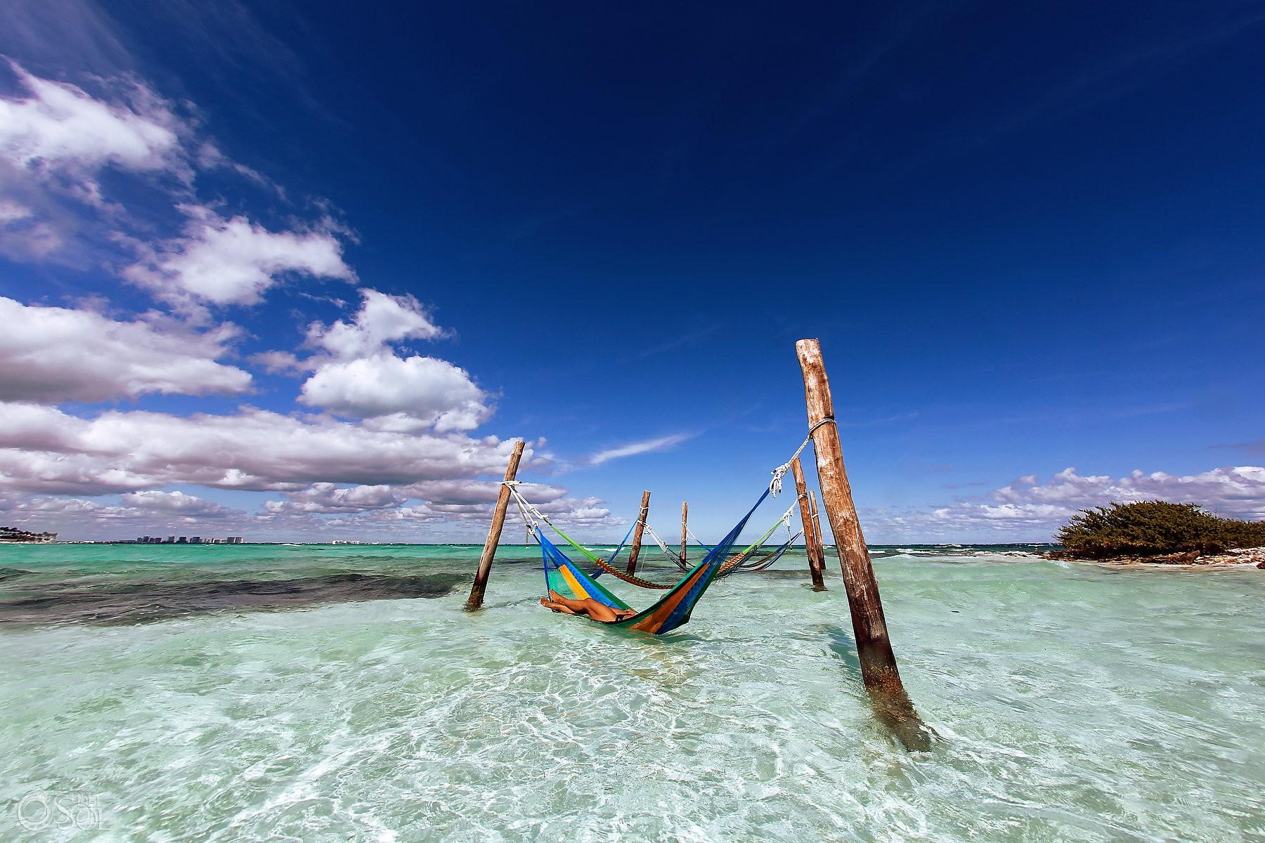 lounging in hammocks at Hyatt Ziva Cancun amazing caribbean turquoise waters