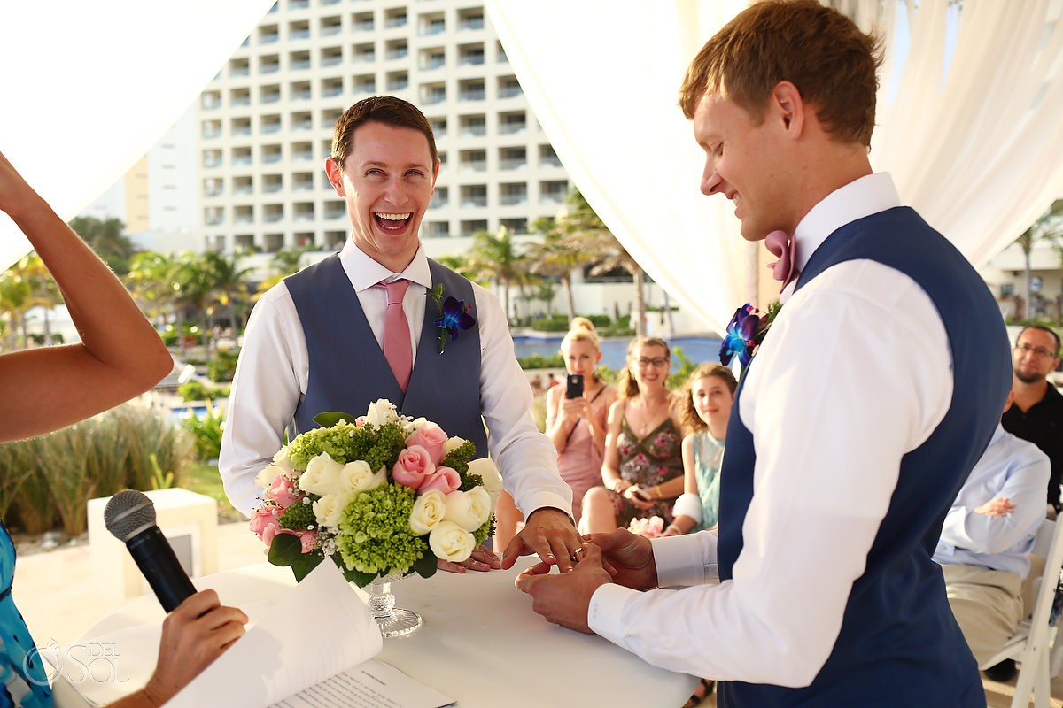 Groom exchange of rings Same sex Destination Wedding Hyatt Ziva Cancun Mexico