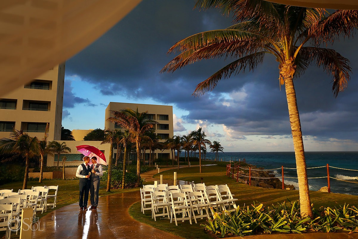 Creative rain wedding picture Same sex Destination Wedding Hyatt Ziva Cancun Mexico travel for love
