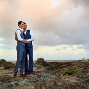 Beach wedding portrait groom and groom lighthouse Same sex Destination Wedding Hyatt Ziva Cancun Mexico