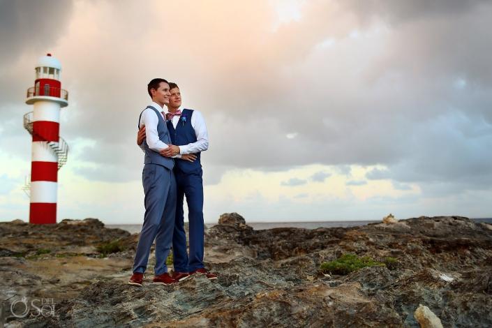 Beach wedding portrait groom and groom lighthouse Same sex Destination Wedding Hyatt Ziva Cancun Mexico