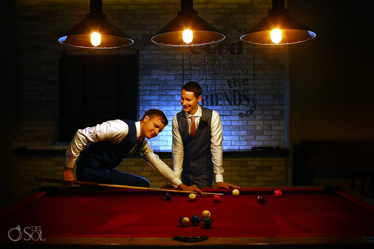 Groom and groom playing pool Same sex Destination Wedding Hyatt Ziva Cancun Mexico