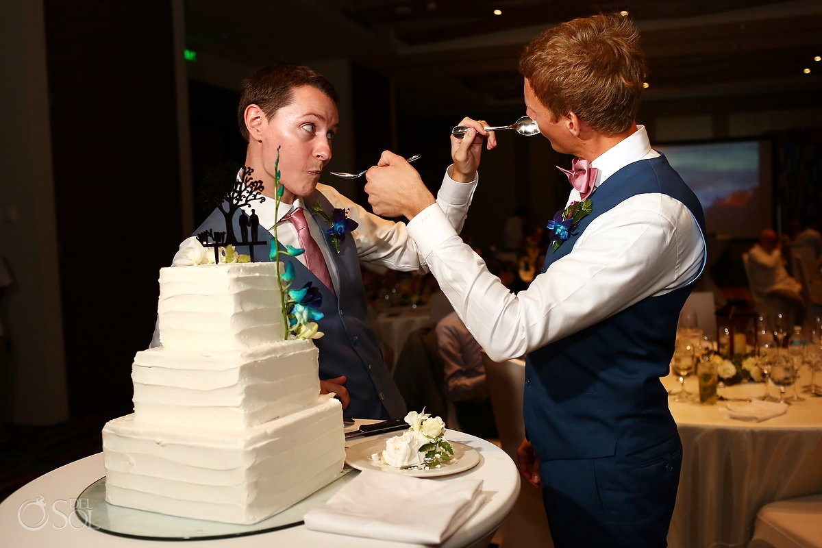 Cake cutting groom and groom Same sex Destination Wedding Hyatt Ziva Cancun Mexico