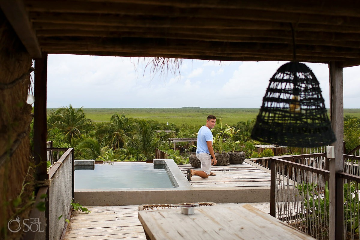 on his knees ready to propose at tulum betulum skydeck jungle surprise proposal