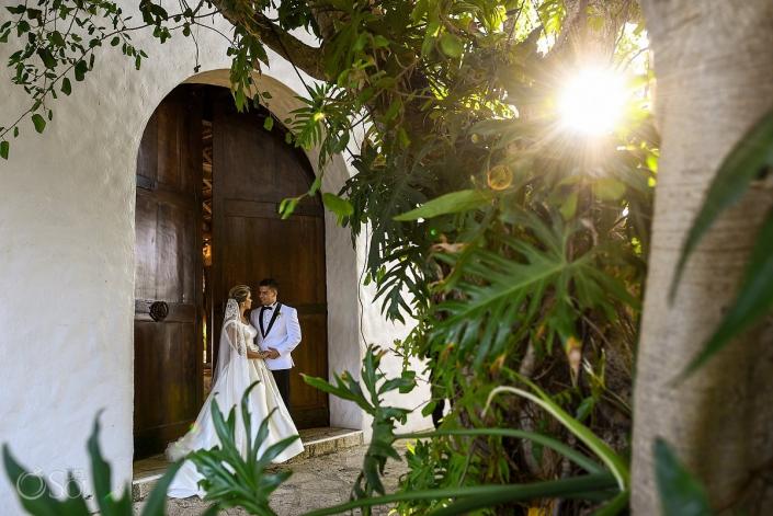 Sun light sunset time bride and groom romantic portraits Xcaret Playa del Carmen Mexico