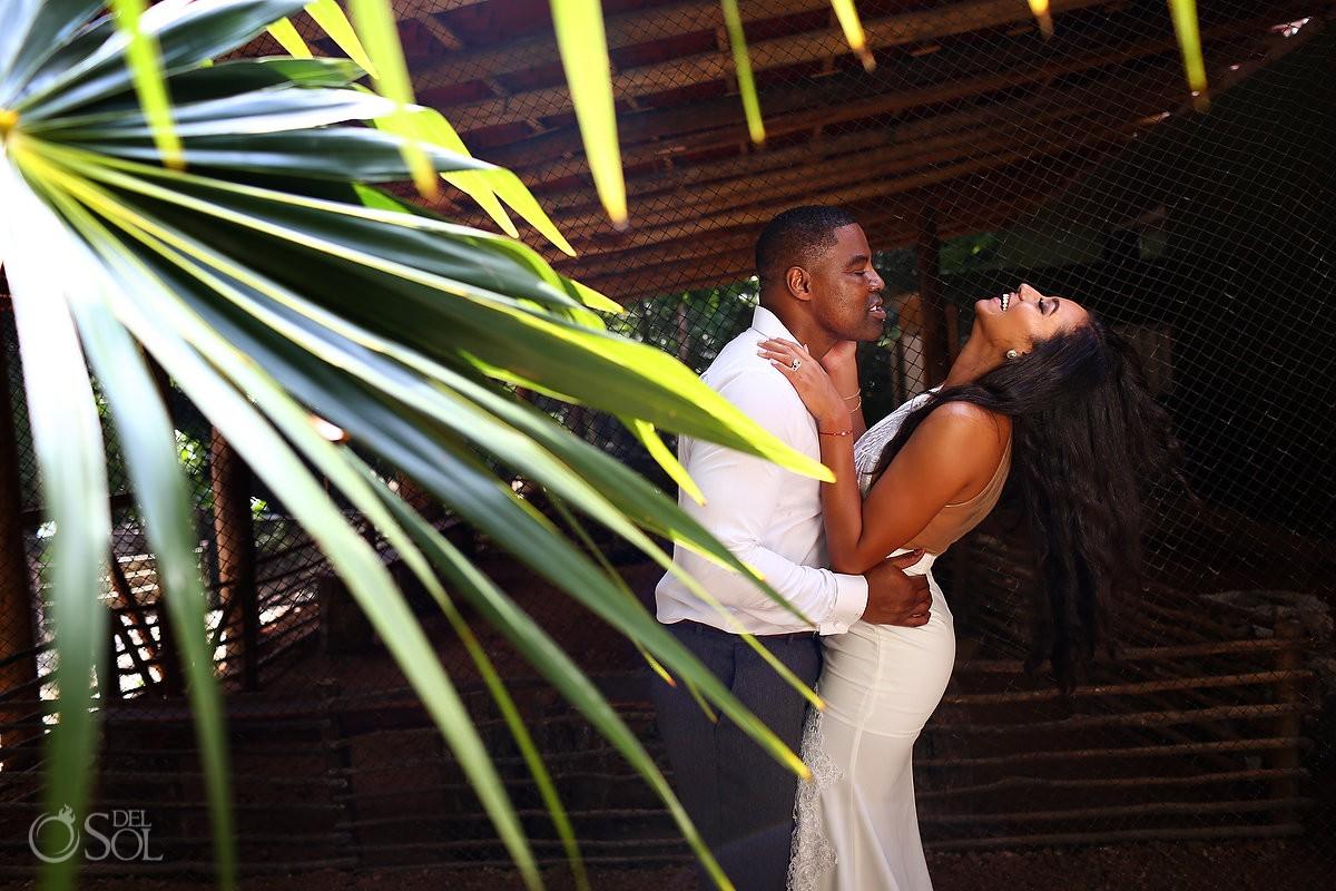 bride and groom having fun jungle Cenote Trash the Dress Riviera Maya Mexico