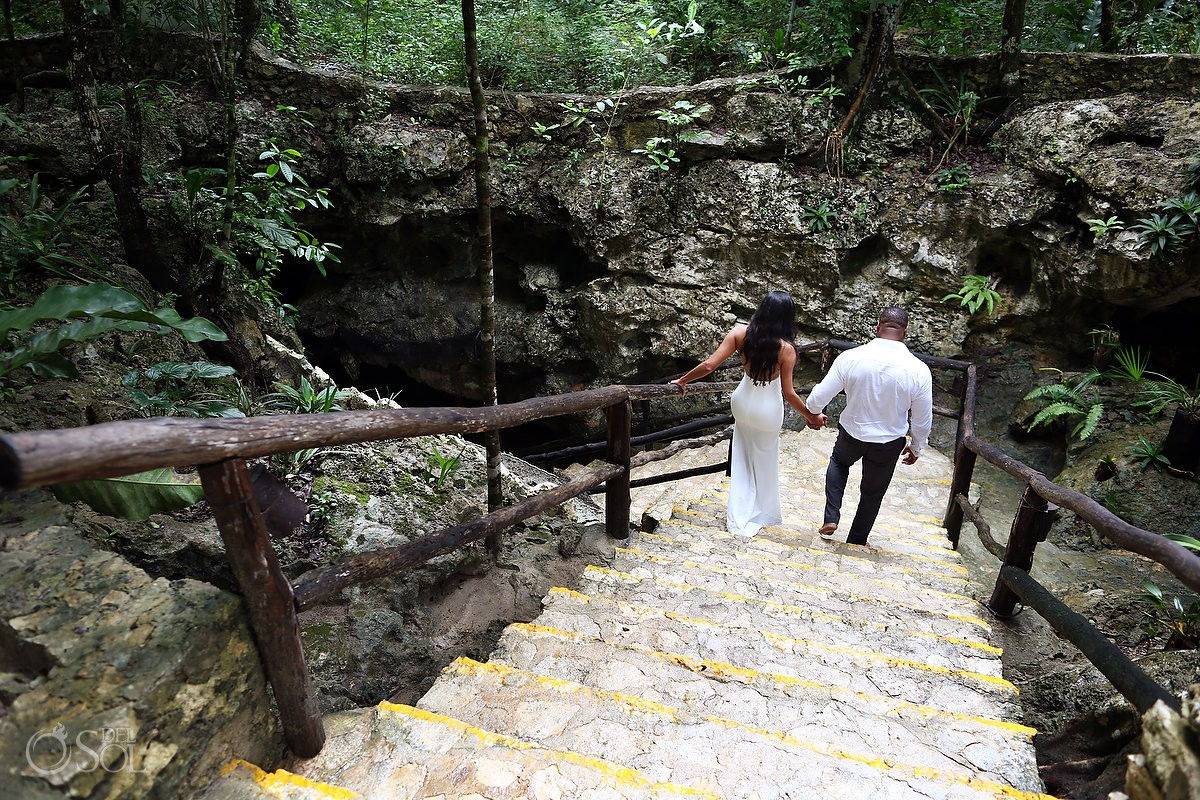Bride and groom walking dow to the Cenote water Trash the Dress Riviera Maya Mexico