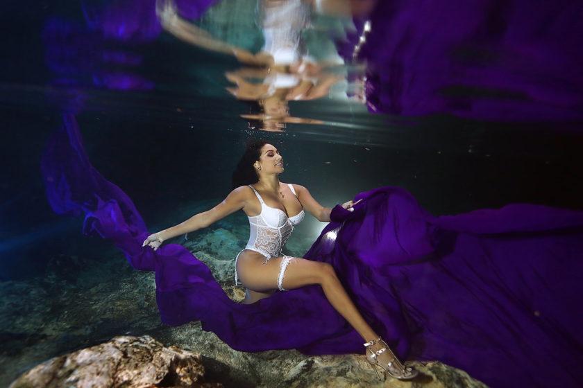 Beautiful bride underwater portrait Cenote Trash the Dress Riviera Maya Mexico