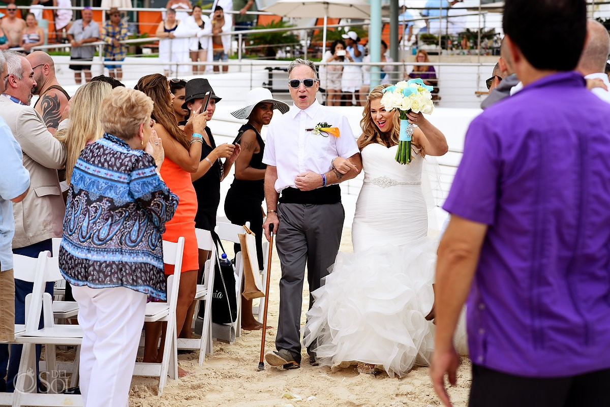 Bride celebrating first look beach wedding ceremony Beach Palace Cancun Mexico