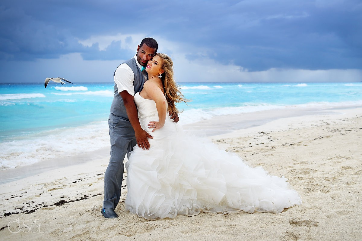 Bride and groom romantic wedding portrait Beach Palace Cancun Mexico