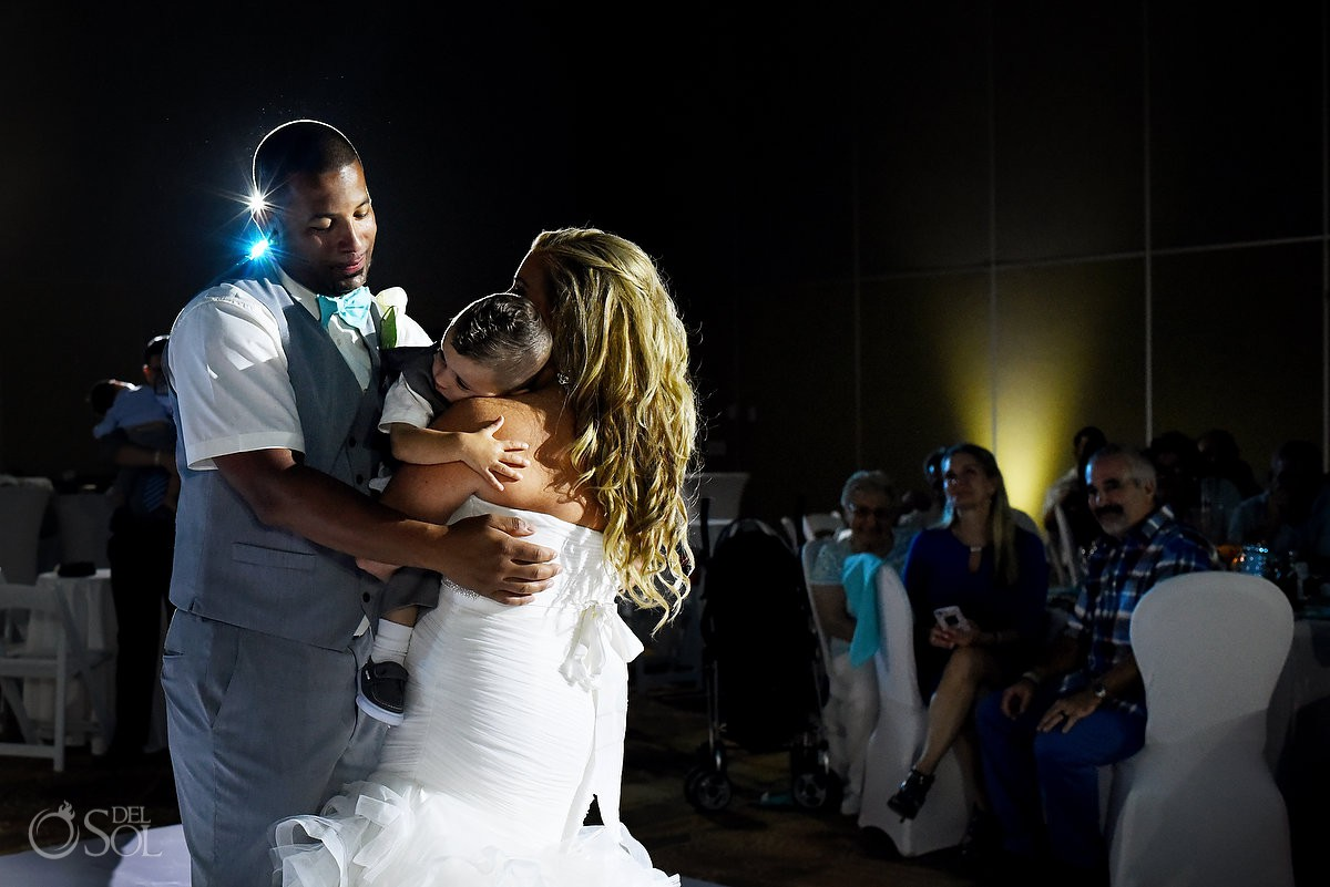Bride and groom dancing with son Beach Palace Cancun Mexico