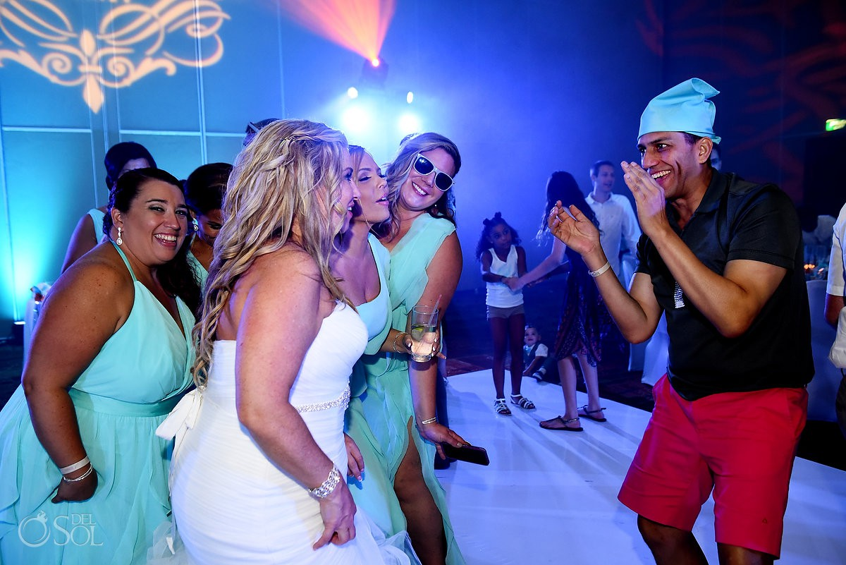 Party time bride and bridesmaids dancing Beach Palace Cancun Mexico