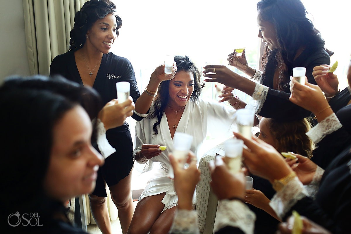 Bride and bridesmaids getting ready tequila toast Kay Club Bahia Petempich Cancun Mexico