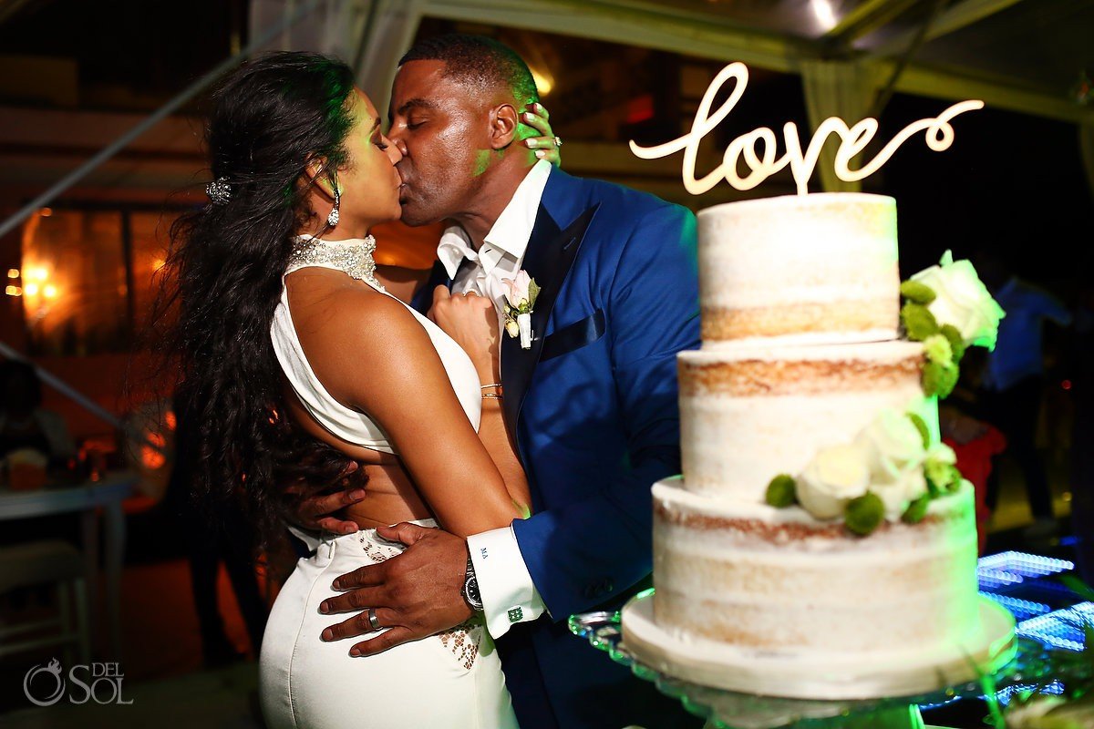 bride and groom love cake cutting romantic wedding portrait Kay Club Bahia Petempich Cancun Mexico
