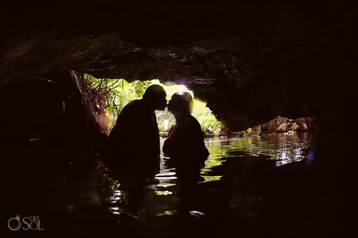 Silhouette kiss cenote Riviera Maya Mexico