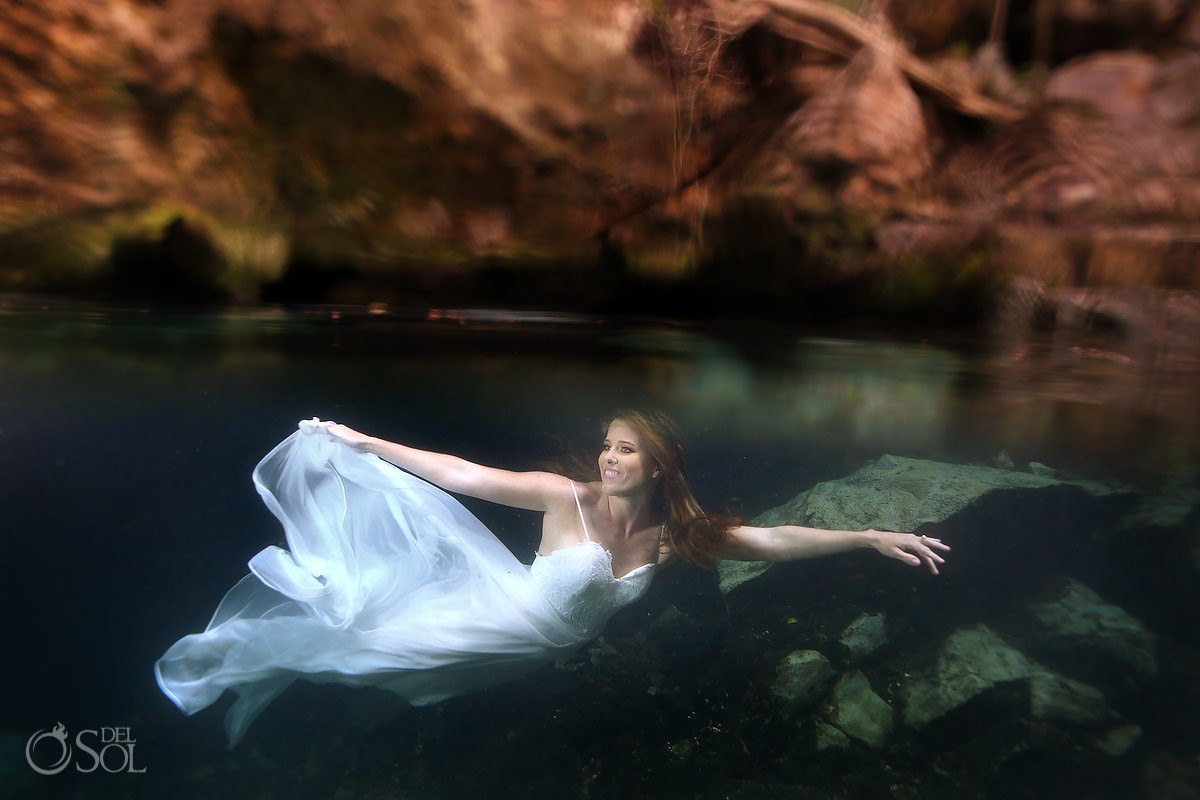 Underwater trash the dress bride swimming