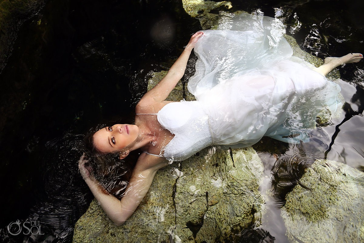 Beautiful bride trash the dress wedding portrait Cenote Riviera Maya Mexico