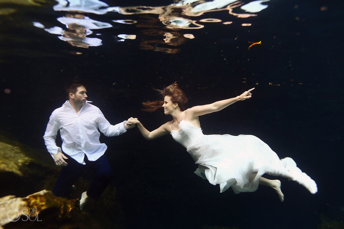 Underwater trash the dress bride and groom