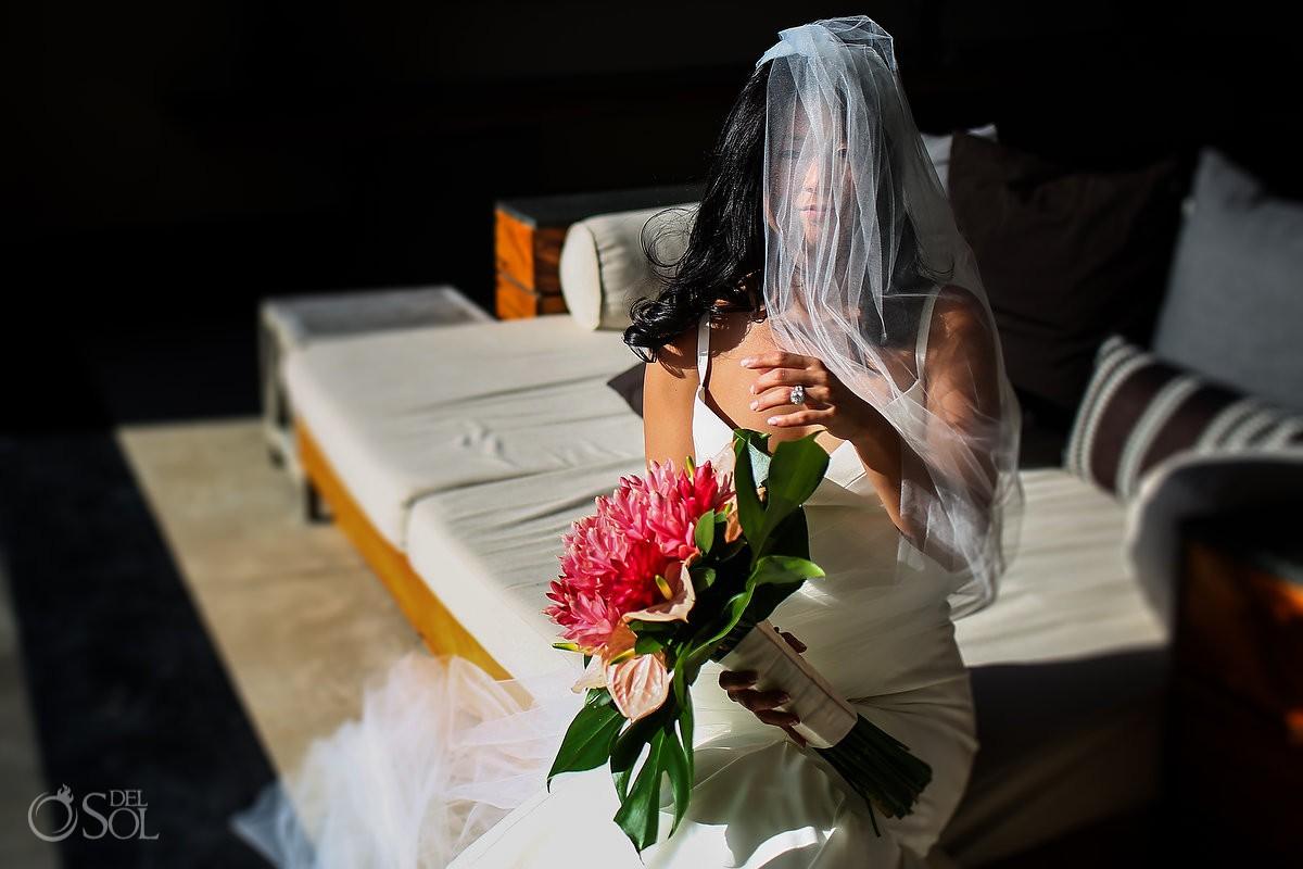 Bride getting ready wedding portraits Cancun Elopement Nizuc Resort and Spa Mexico