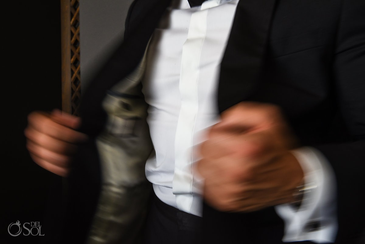 Groom getting ready Cancun Elopement Nizuc Resort and Spa Mexico