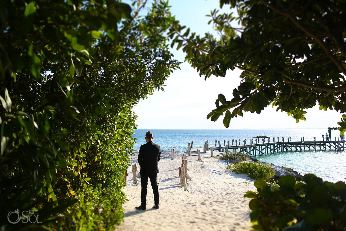 Groom waiting first look Cancun Elopement Nizuc Resort and Spa Mexico