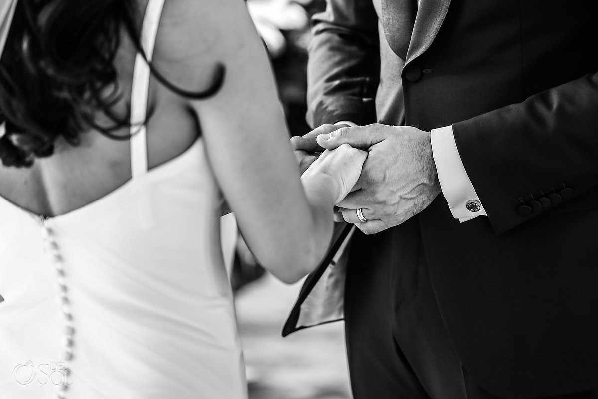bride and groom holding hands Cancun Elopement Nizuc Resort and Spa Mexico wedding for two