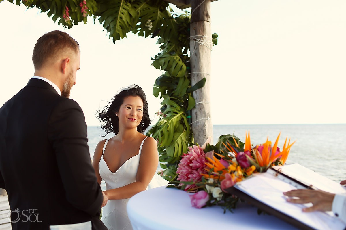 Bride and groom beach wedding ceremony Cancun Elopement Nizuc Resort and Spa Mexico