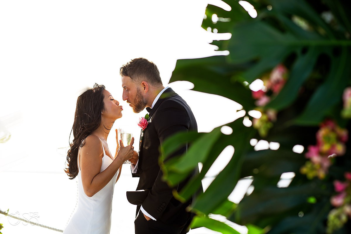 Bride and groom first kiss Cancun Elopement Nizuc Resort and Spa Mexico