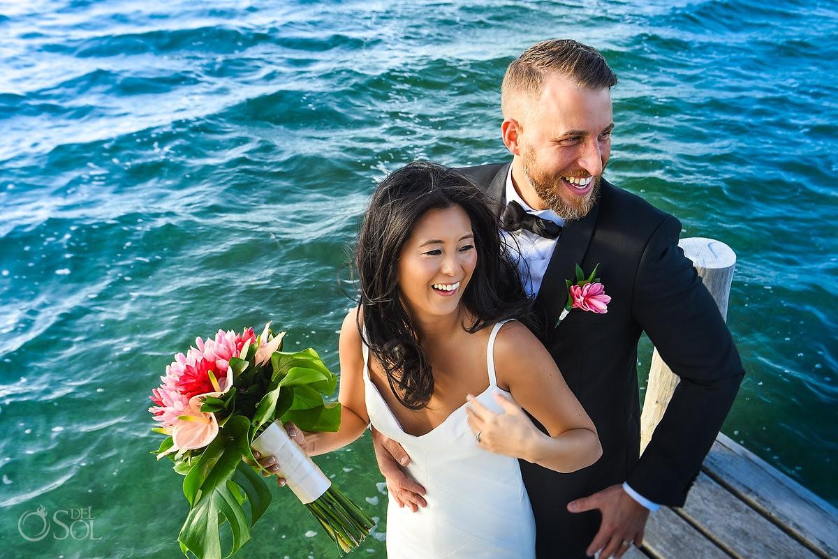 Bride and groom having fun at beach Cancun Elopement Nizuc Resort and Spa Mexico