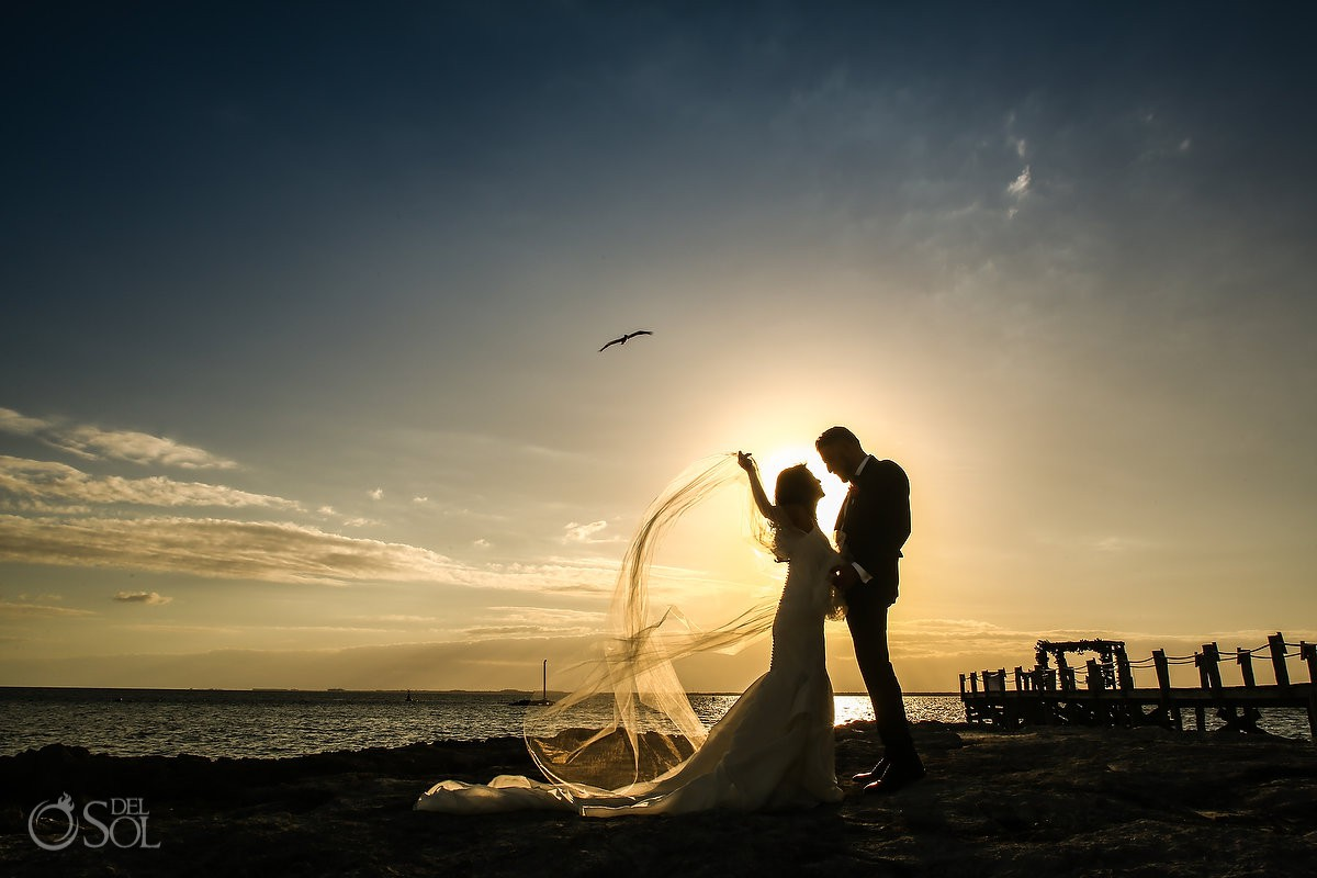 Bride and groom sunset silhouette Cancun Elopement Nizuc Resort and Spa Mexico