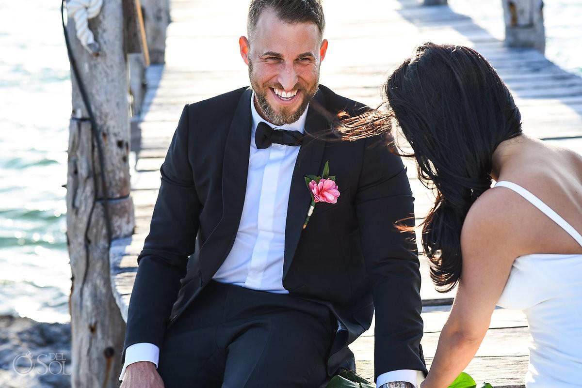 bride and groom enjoying wedding photo shooting Cancun Elopement Nizuc Resort and Spa Mexico