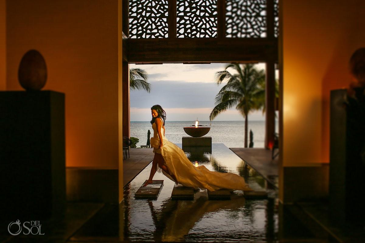 Bride jumping amazing wedding dress Cancun Elopement Nizuc Resort and Spa Mexico
